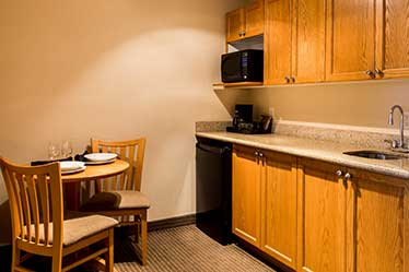 Executive King Suite kitchen area with mini fridge and microwave